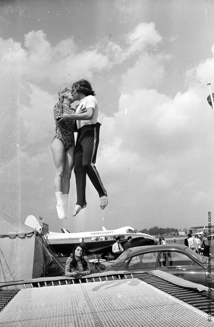 1973: World trampolining champion Paul Luxon and his fiancee, German Ladies Champion Ute Czech, get together for a mid-air kiss at the Biggin Hill Air Fair