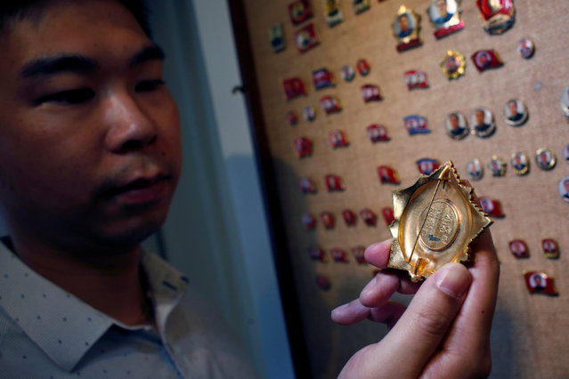 Thomas Hui displays an Order of Kim Il Sung badge, the top order in North Korea, with a smudge at the back which may suggest a scrapped serial number, at his apartment in Hong Kong, China April 11, 2016. (Photo by Bobby Yip/Reuters)