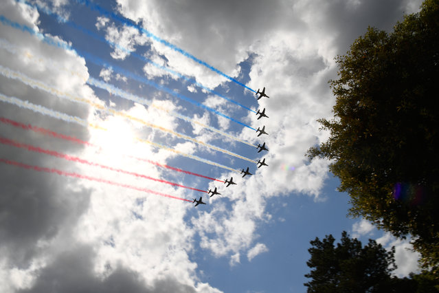"""French elite acrobatic flying team """"Patrouille de France"""" (PAF) perform over the Normandy American Cemetery in Colleville-sur-Mer in Normandy, northwestern France, at the end of a French-US ceremony, on June 6, 2019, as part of D-Day commemorations marking the 75th anniversary of the World War II Allied landings in Normandy. (Photo by Damien Meyer/AFP Photo)"""