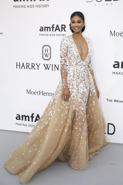 Model Chanel Iman poses for photographers upon arrival for the amfAR Cinema Against AIDS benefit at the Hotel du Cap-Eden-Roc, during the 68th Cannes international film festival, Cap d'Antibes, southern France, Thursday, May 21, 2015. (Photo by Thibault Camus/AP Photo)