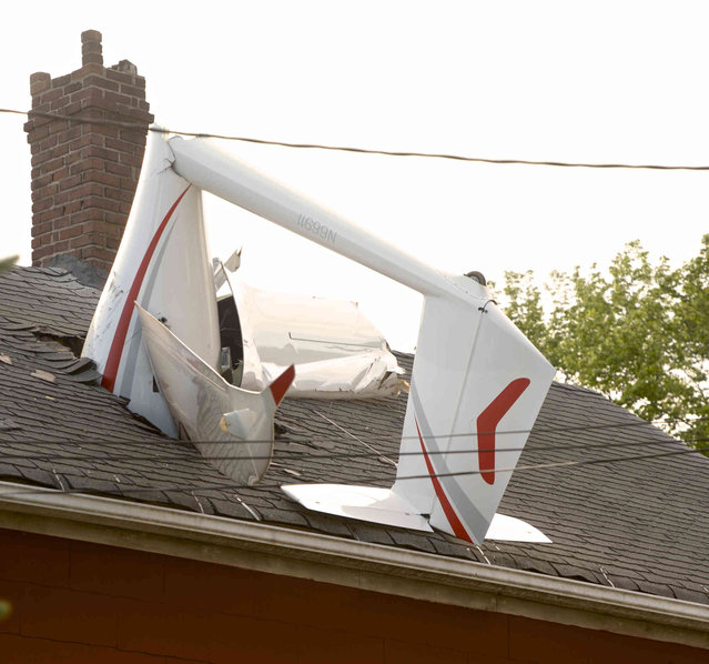 In this Tuesday evening, June 4, 2019 photo, a glider, flown by a local business owner, crashed into a house on Golden Hill Avenue while making its approach to Danbury Airport, in Danbury, Conn. Officials say the pilot sustained minor injuries. (Photo by H. John Voorhees III/Hearst Connecticut Media via AP Photo)