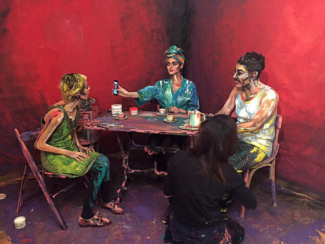 Cairo-based artist Chanel Arif's paints for her art project called After Dinner that uses humans and their surroundings as her canvas, in her gallery in the capital of Cairo, Egypt March 2, 2017. (Photo by Sherif Fahmy/Reuters)