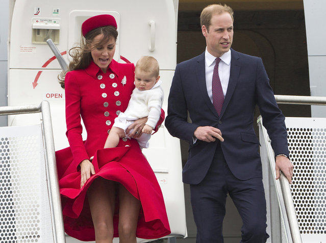 Britain's Prince William and his wife Kate, the Duchess of Cambridge with Prince George arrive for their visit to New Zealand at the International Airport, in Wellington, New Zealand, Monday, April 7, 2014. (Photo by David Rowland/AP Photo/SNPA)