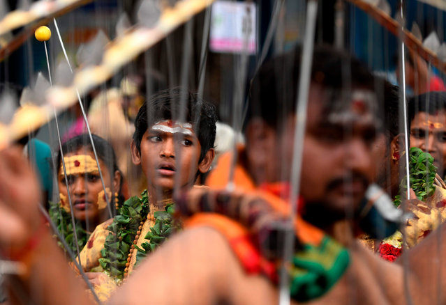 """Tamil Hindu devotees with metal rods pierced in their bodies take part in rituals on the occasion of """"Aadi"""" festival in Chennai on July 28, 2019. """"Aadi"""" is considered a holy month by Tamils and is celebrated with rituals worshipping Hindu gods. (Photo by Arun Sankar/AFP Photo)"""