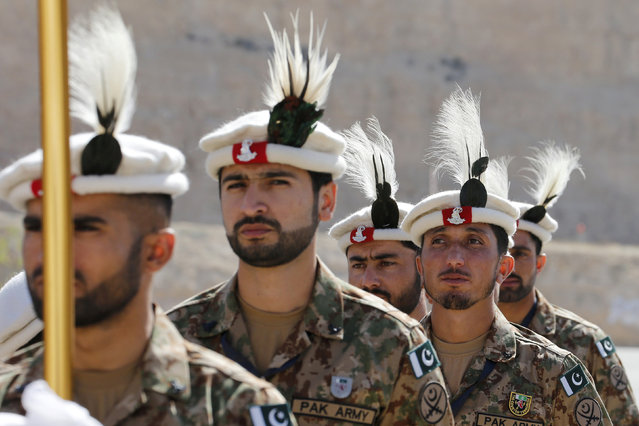 Members of the Pakistani team stand to attention during the opening ceremony of eighth annual Warrior Competition at the King Abdullah Special Operations Training Center (KASOTC) in Amman, Jordan, May 2, 2016. (Photo by Muhammad Hamed/Reuters)