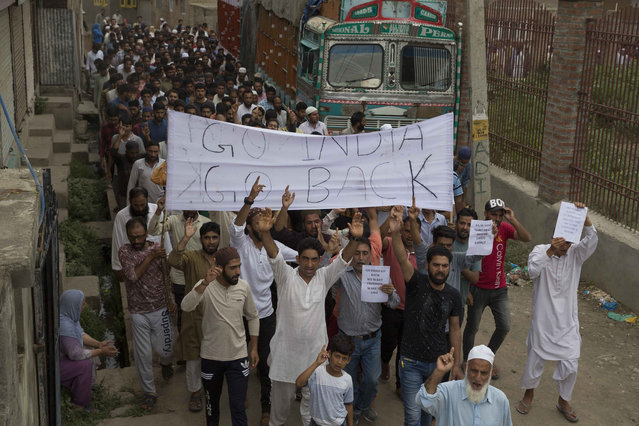 Kashmiri Muslims shout pro-freedom slogans during a demonstration after Friday prayers amid curfew like restrictions in Srinagar, India, Friday, August 16, 2019. India's government assured the Supreme Court on Friday that the situation in disputed Kashmir is being reviewed daily and unprecedented security restrictions will be removed over the next few days, an attorney said after the court heard challenges to India's moves. (Photo by Dar Yasin/AP Photo)