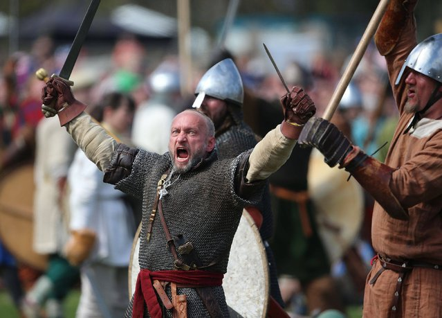 People dressed as Vikings participate in a reenactment of the Battle of Clontarf hosted by Dublin City Council at St Annes Park in Raheny, on April 19, 2014. (Photo by Niall Carson/PA Wire)