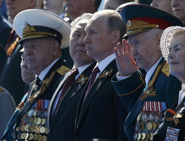 Russian President Vladimir Putin (3rd R), Kazakh President Nursultan Nazarbayev (3rd L) and World War Two veterans attend the Victory Day parade, marking the 71st anniversary of the victory over Nazi Germany in World War Two, at Red Square in Moscow, Russia, May 9, 2016. (Photo by Grigory Dukor/Reuters)