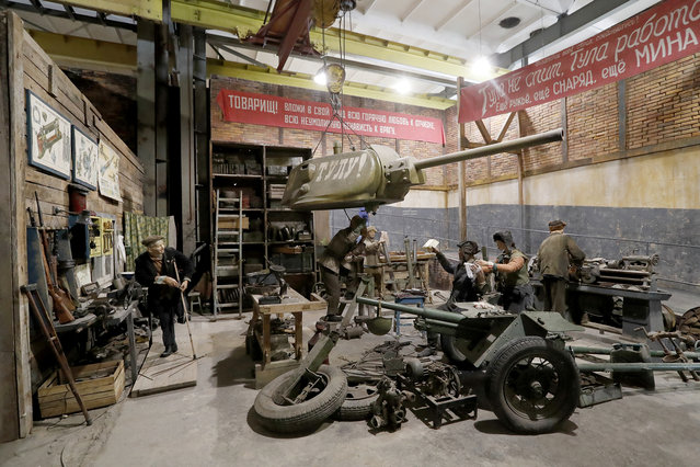 "A scene showing ""Workers of the Tula arms factory"" during World War II is prepared for the opening of the 3D Panorama exhibition ""Memory talks. The road through war"" in the former Sevcabel port in St. Petersburg, Russia, 16 September 2019. (Photo by Anatoly Maltsev/EPA/EFE)"
