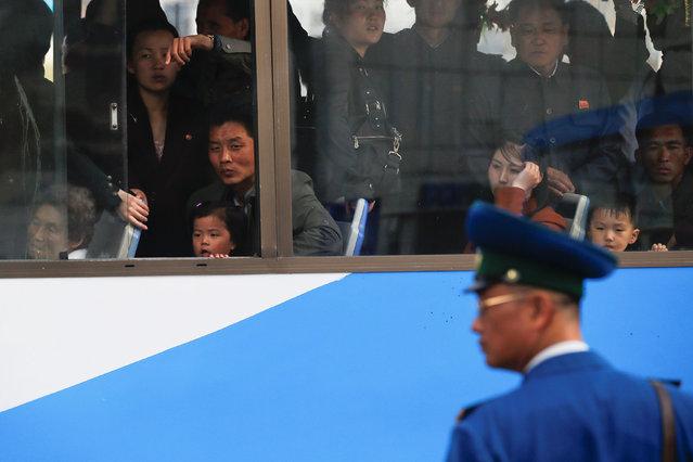 People look from inside the bus in central Pyongyang, North Korea April 16, 2017. (Photo by Damir Sagolj/Reuters)