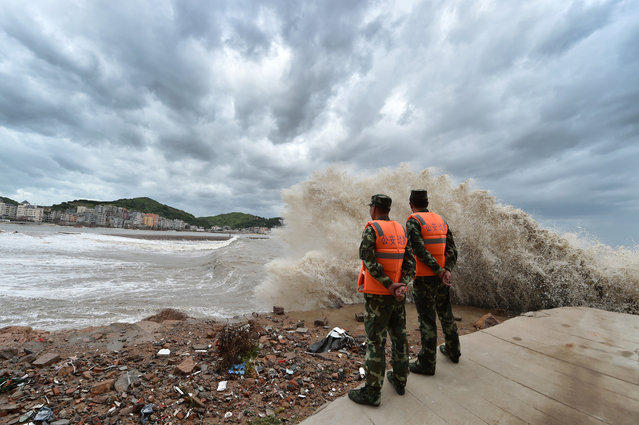 Frontier defence soldiers keep guard on the shore in Sansha Township of Xiapu, southeast China's Fujian Province, July 10, 2015. (Photo by Jiang Kehong/Xinhua)