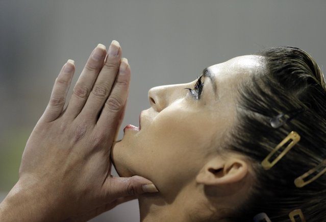 Brazil's Daniele Matias Hypolito looks skyward as she waits for her score on the balance beam during women's artistic gymnastics team competition in the Pan Am Games in Toronto, Sunday, July 12, 2015. Brazil took the bronze medal, the United States won the gold, and Canada won the silver in the event. (Photo by Gregory Bull/AP Photo)
