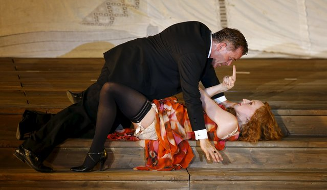 "Actor Cornelius Obonya as Jedermann and actress Brigitte Hobmeier as Buhlschaft perform on stage during a dress rehearsal of Hugo von Hofmannsthal's drama ""Jedermann"" (Everyman) at Domplatz square in Salzburg, Austria, July 16, 2015. (Photo by Leonhard Foeger/Reuters)"