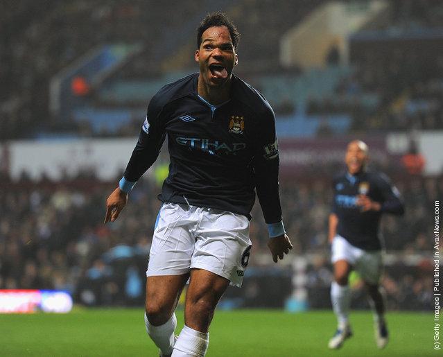 Joleon Lescott of Man City celebrates scoring to make it 1-0 during the Barclays Premier league match between Aston Villa and Manchester City at Villa Park