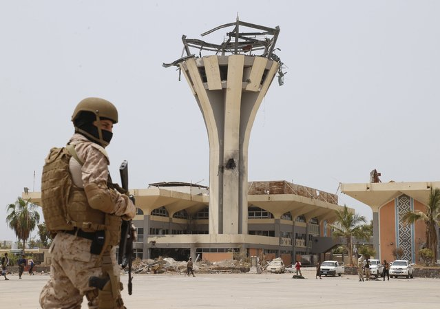 A Saudi soldier stands guard at the international airport of Yemen's southern port city of Aden July 24, 2015. Two Saudi aircraft landed at Aden on Friday bringing equipment needed to re-open the city's airport four months after the Yemeni civil war shut it down, Saudi-owned Al Arabiya TV reported. (Photo by Faisal Al Nasser/Reuters)