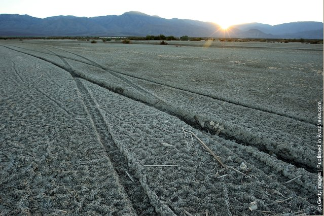 Tire tracks cross the soft mud of the shore of the Salton Sea in an area where a controversial development would create a new town for nearly 40,000 people on the northwest shore of the biggest lake in California, the Salton Sea