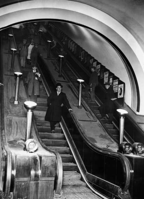 Passengers on the giant escalators at the newly opened Piccadilly Underground Station, London, designed by Charles Holden, 1928. (Photo by Topical Press Agency/Getty Images)