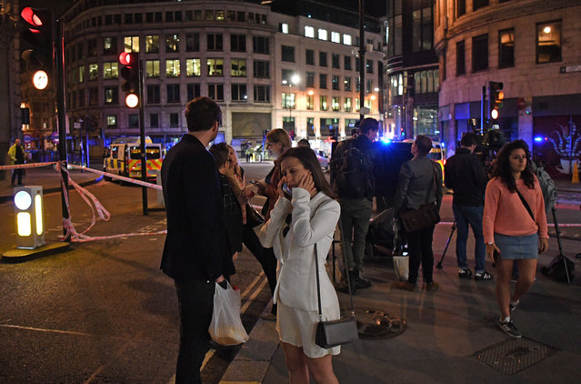 Members of the public look on as a police close off the area by Monument station on June 3, 2017 in London, England. Police have responded to reports of a van hitting pedestrians on London Bridge in central London. (Photo by Leon Neal/Getty Images)