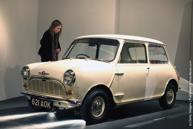 A visitor looks at a Morris Mini-Minor Car on display at the Victoria and Albert museums' new major exhibition