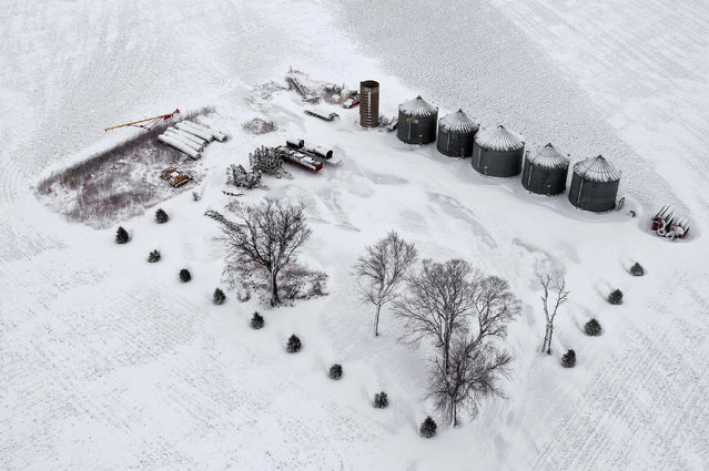 Aerial view snow blanketing farm on November 27, 2019 in Rudd, Iowa. A winter storm, which dumped rain, ice, snow and brought high winds into much of the upper Midwest, has been hampering holiday travel by road and by air on one of the busiest travel days of the year. (Photo by Scott Olson/Getty Images)
