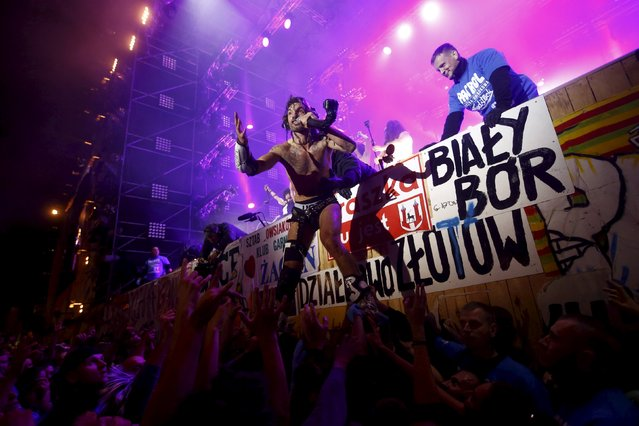 Vocalist Frah of Shaka Ponk performs as he jumps to the crowd from the main stage during the 21st Woodstock Festival in Kostrzyn-upon-Odra, Poland July 30, 2015. (Photo by Kacper Pempel/Reuters)