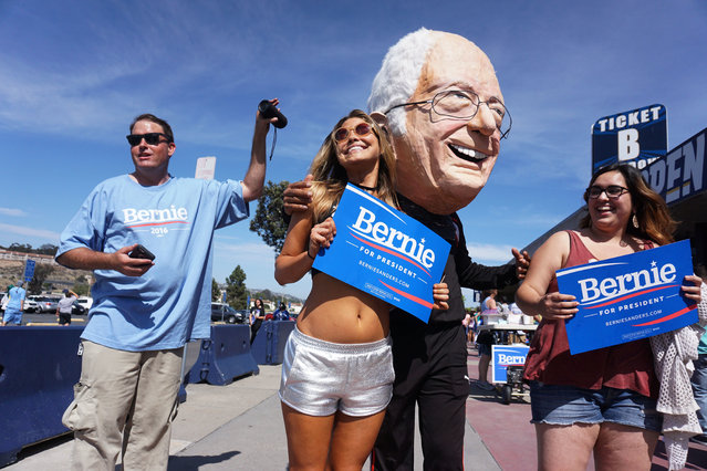 Supporters cheer ahead of a campaign rally for Democratic presidential candidate Sen. Bernie Sanders, I-Vt,. at Qualcomm Stadium on Sunday, June 5, 2016, in San Diego. (Photo by Sandy Huffaker/AP Photo)