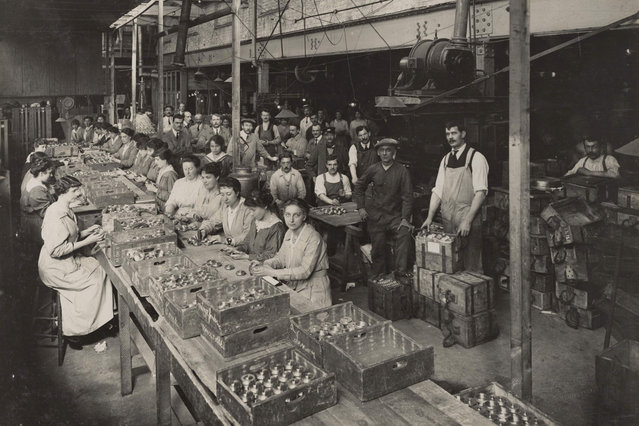 A view of women working at the Brewery Road Works munitions factory in this 1916 handout picture. This picture is part of a previously unpublished set of World War One (WWI) images from a private collection. The pictures offer an unusual view of varied and contrasting aspects of the conflict, from high tech artillery to mobile pigeon lofts, and from officers partying in their headquarters to the grim reality of life and death in the trenches. The year 2014 marks the centenary of the start of the war. (Photo by Reuters/Archive of Modern Conflict London)