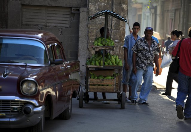 People walk on a street in Havana  July 20, 2015. (Photo by Enrique De La Osa/Reuters)