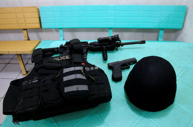 Philippine National Police Special Reactions Unit equipment is seen on a table in preparation for a agility test inside the police station in metro Manila, Philippines May 21, 2016. (Photo by Romeo Ranoco/Reuters)