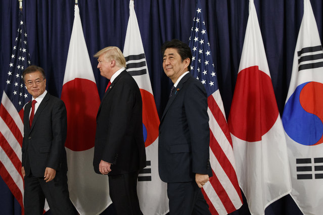 President Donald Trump meets with Japanese Prime Minister Shinzo Abe, right, and South Korean President Moon Jae-in before the Northeast Asia Security dinner at the US Consulate General Hamburg, Thursday, July 6, 2017, in Hamburg. (Photo by Evan Vucci/AP Photo)