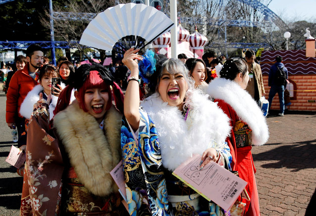 Japanese women wearing kimonos react as they attend their Coming of Age Day celebration ceremony at Toshimaen amusement park in Tokyo, Japan, January 13, 2020. (Photo by Kim Kyung-Hoon/Reuters)
