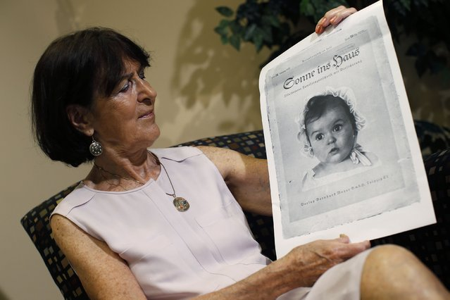 Hessy Levinsons Taft holds a photograph of herself taken in 1935, when she was 6 months old, by the German photographer Hans Ballin during an interview with Reuters, on Jule 9, 2014. The photographer submitted his picture of her, a Jewish child, in a contest for a photo of the ideal Aryan for Nazi propagandists. Her portrait was chosen by Nazis and reprinted on the cover of a magazine, on postcards and on store signs. (Photo by Mike Segar/Reuters)