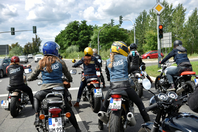 Participants ride motorbikes during a ride out at the women-only Petrolettes motorcycle festival in Neuhardenberg near Berlin, Germany on July 29, 2017. (Photo by Stefanie Loos/Reuters)