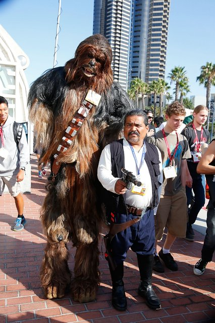 Fans in costume attend Comic-Con International 2014 – Day 1 on July 24, 2014 in San Diego, Calif. (Photo by Joe Scarnici/FilmMagic/Getty Images)