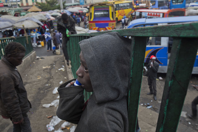 A Kenyan street child stands on a footbridge overlooking the bus station in Nairobi, Kenya, Monday August 7, 2017. (Photo by Jerome Delay/AP Photo)