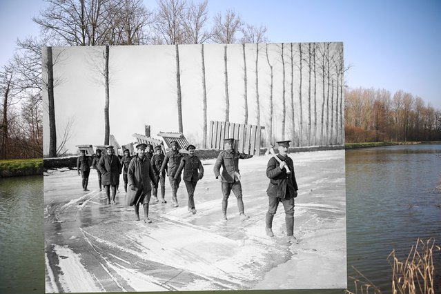 Trees surround the Somme canal on March 12, 2014 in Frise, France. Inset: members of a Royal Garrison Artillery working party carrying duck-boards across the frozen Somme canal at Frise, March 1917. (Photo by Peter Macdiarmid/Getty Images)