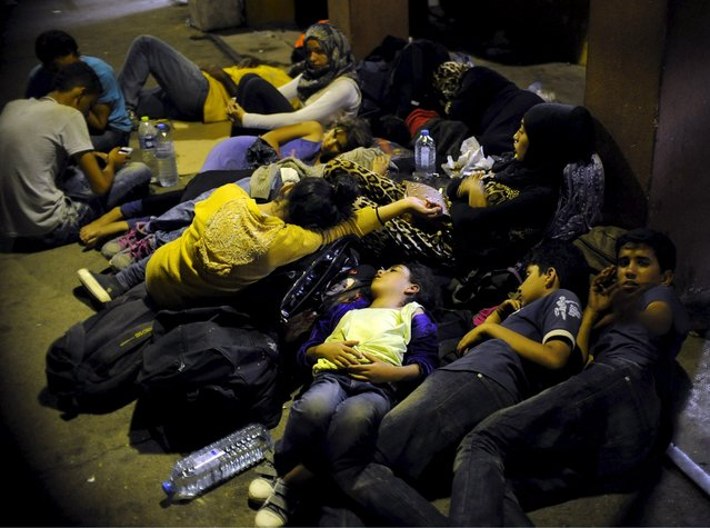 Immigrants sleep at Gevgelija railway station, Macedonia August 19, 2015. (Photo by Ognen Teofilovski/Reuters)