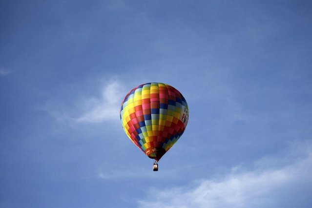 A hot air balloon floats in the air during the 2016 International Hot Air Balloon Festival in Taitung, southeast of Taiwan, 01 July 2016. (Photo by Ritchie B. Tongo/EPA)
