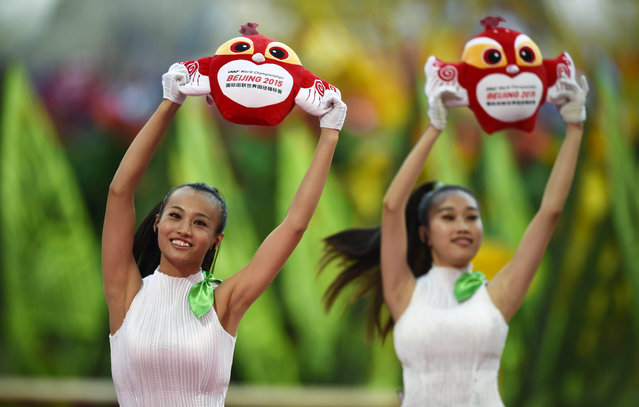 Performers dance with dolls of the official mascot during the opening ceremony of the 15th IAAF World Championships at the National Stadium in Beijing, China August 22, 2015. (Photo by Dylan Martinez/Reuters)