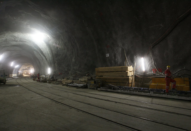 A worker stands at the construction site of the NEAT Gotthard Base Tunnel July 16, 2009. (Photo by Arnd Wiegmann/Reuters)