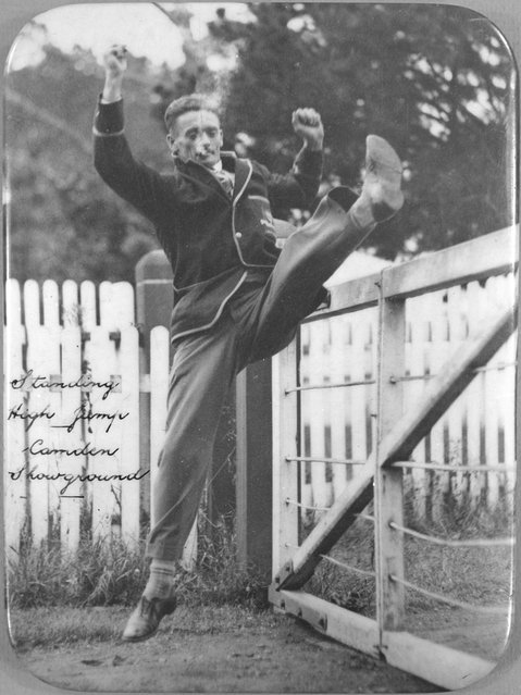 Athlete Nick Winter performing a standing high jump, Camden Showground, New South Wales, ca. 1925