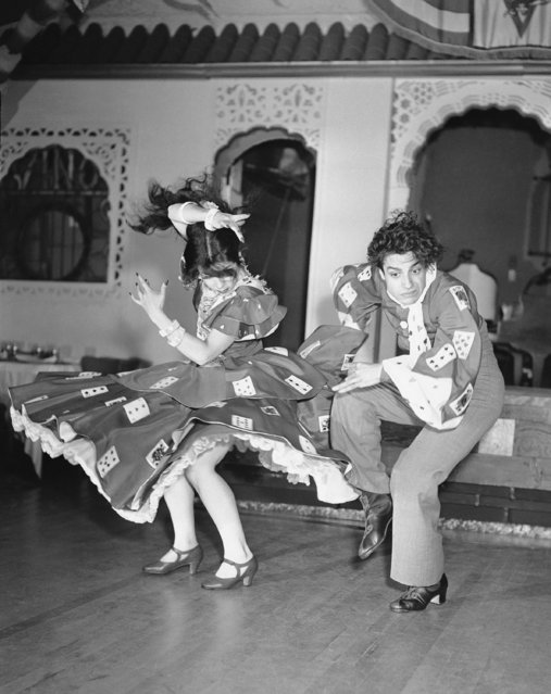 Rosario Perez and Antonio Ruiz are cousins who began to dance when they were kids in the streets of Sevelle in their native Andalusia. These photos of them, performing on a portable stage at the Latin sport, with a largely Latin audience on August 28, 1943, show steps from dances interpretative of various South American countries. (Photo by AP Photo/DG)