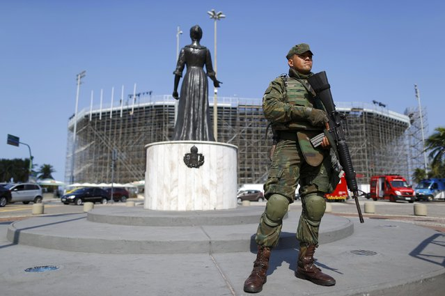2016 Rio Olympics, Olympic Park on July 29, 2016. A soldier stands in front of the Olympic beach volley ball venue on Copacabana. (Photo by Ivan Alvarado/Reuters)