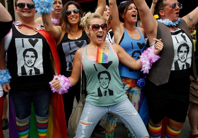 A crowd cheers for Canada's Prime Minister Justin Trudeau while wearing t-shirts with his face printed on them as he walks in the Vancouver Pride Parade in Vancouver, British Columbia, July 31, 2016. (Photo by Ben Nelms/Reuters)