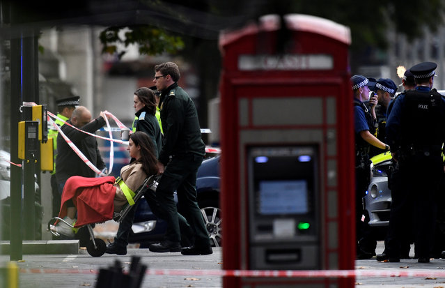 A paramedic wheels a woman on a stretcher to an ambulance, following an incident at the junction of Exhibition Road and Cromwell Road, between the Victoria and Albert (V& A) museum and the Natural History Museum, in the South Kensington district of London on October 7, 2017. Police arrested a man near London' s Natural History Museum on Saturday after a vehicle apparently drove into pedestrians, injuring a number of people. Crowds in the busy tourist spot in South Kensington, which is also home to the Victoria & Albert Museum and the Science Museum, fled screaming in panic, an AFP reporter said. (Photo by Dylan Martinez/Reuters)