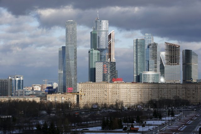 """A general view shows residential buildings, with skyscrapers of the Moscow International Business Center, also known as """"Moskva-City"""", seen in the background, in Moscow, Russia, February 4, 2016. (Photo by Sergei Karpukhin/Reuters)"""