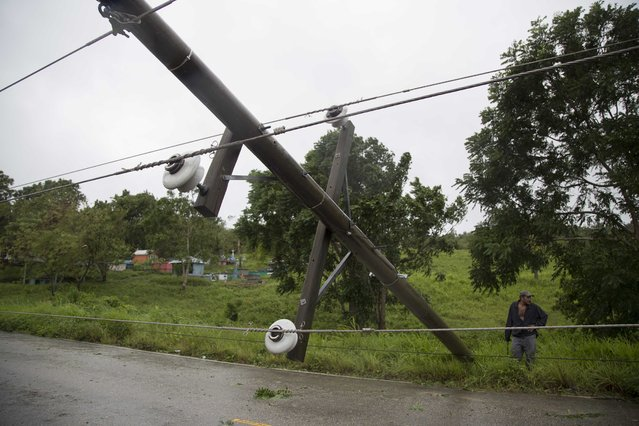 Power lines collapsed by Hurricane Earl hinder traffic on the road from Flores, in Peten, the northern Guatemalan border state with Belize, Thursday, August 4, 2016. Earl deteriorated to a weak tropical storm Thursday as it passed over northern Guatemala en route to southern Mexico. (Photo by Luis Soto/AP Photo)
