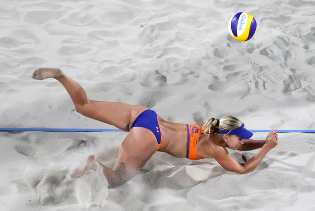 Netherlands' Marleen van Iersel dives for a ball during a women's beach volleyball match against Costa Rica at the 2016 Summer Olympics in Rio de Janeiro, Brazil, Monday, August 8, 2016. (Photo by Petr David Josek/AP Photo)