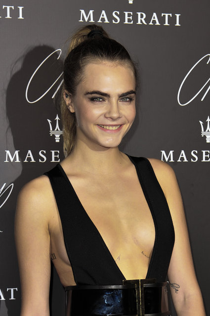 Cara Delevingne poses at to Carine Roitfeld & Stephen Gan celebration of the launch of CR Fashion Book N.5 in Paris, Tuesday, September 30, 2014. (Photo by Zacharie Scheurer/AP Photo)