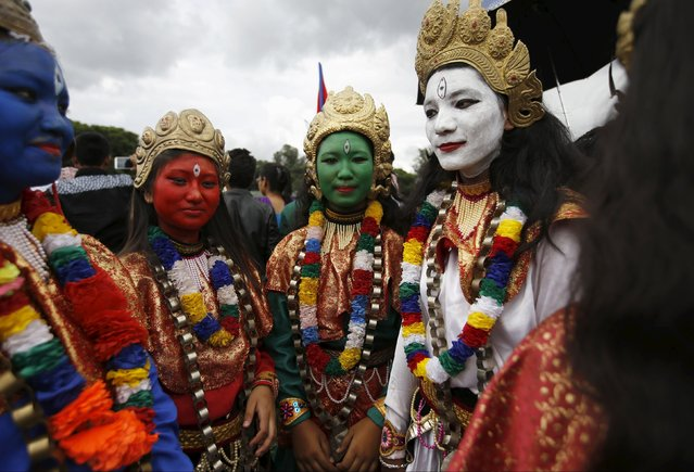 Women with their faces painted as various Hindu deities take part in a celebration a day after the first democratic constitution was announced in Kathmandu, Nepal September 21, 2015. (Photo by Navesh Chitrakar/Reuters)